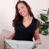 Senior dark haired gal does a slow striptease while getting rid of a mini-skirt and heels