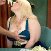 Fat blonde porn star Dawn Davenport tugs on a cock while eating a lot of food and masturbating