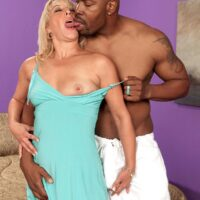 Uber-sexy grandma Andi Roxxx has her gash ate out by her younger ebony paramour