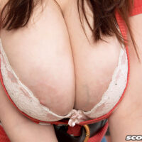 Sexy girl Sofie Style whips out her fine breasts in the kitchen before showing her muff