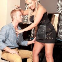 Gawky platinum-blonde stunner Krystal Swift whips out her lovely hooters from a sundress for nipple play