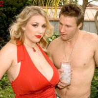 Plump platinum-blonde solo girl Shyla Shy revealing immense juggs and hard nipples while outdoors