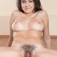 Nimble dark-haired amateur with huge all natural boobies frees her fur covered honeypot from underneath yoga pants