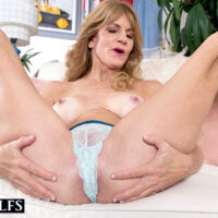 Aged MILF Denise Day releases her tan lined figure from see-thru lingerie and pretties