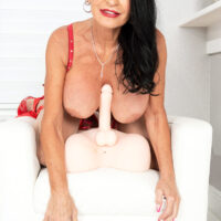Buxom brunette grannie Rita Daniels toys and fingers her coochie during solo activity