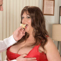 Fat female Jennifer licks a plate of sweets while taking a jizz shot on her humungous tits