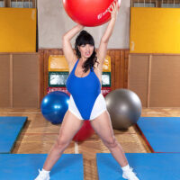 Fat solo chick Joana Bliss whips out her giant breasts during a workout in latex