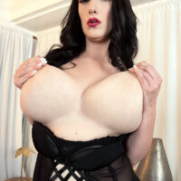 Big first-timer Suki Ski sets her immense tits loose of sensuous lingerie in nylons