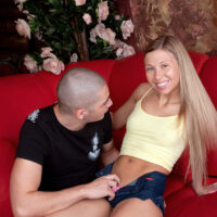 Young looking blonde Nastya is stripped naked prior to getting on top of a cock