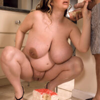 Massive boobed fatty April McKenzie gets on top of a cock while devouring a cake