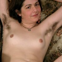 European amateur Gypsy shows off her pierced nipples and her fur covered pits and bush