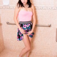 Brown-haired teenager Cadey Mercury flashes her seductive upskirt caboose before baring her diminutive boobies