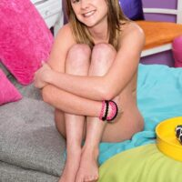 Lovely teener Lizzy Bell unsheathes her puffy tiny titties as she gets nude atop her bed