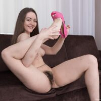 Barefoot brown-haired amateur Virgin Bloom touting her amazing gams and fur covered vagina
