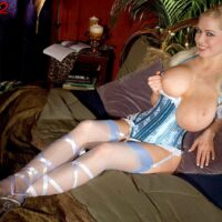 Light-haired solo girl Kylee Nash freeing her immense breasts in super-sexy lingerie and tights