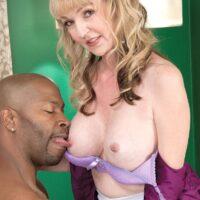 Small granny Janee Diamond reveals her enormous tits before sucking a hefty ebony penis