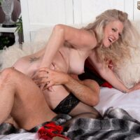Elderly fair-haired gal Val Kambel seduces a junior boy in stunning lingerie and hose