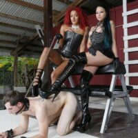 Domineering type Daisy Ducati and her friend dominate a male submissive in high-heeled footwear