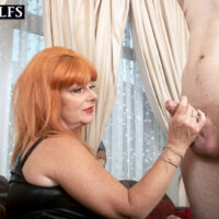 Redheaded cougar Melanie Taylor tempts a younger stud in a ebony leather dress