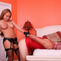 Redhead wife Nikki Delano fucks her sissy boy in the bum with a strapon cock in pantyhose