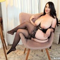 First-timer Suki Ski sets her big titties loose of sensuous lingerie in pantyhose